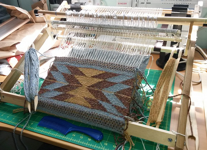 Navajo weaving on table loom