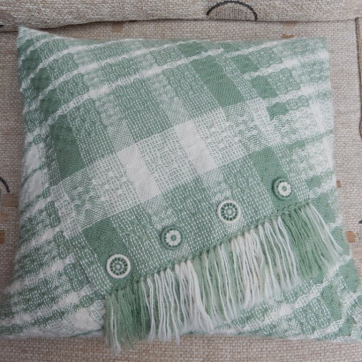 Rigid heddle cushion in 5/1 spot lace with Dorset buttons