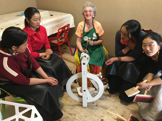 Amanda demonstrating spinning using a Bliss wheel