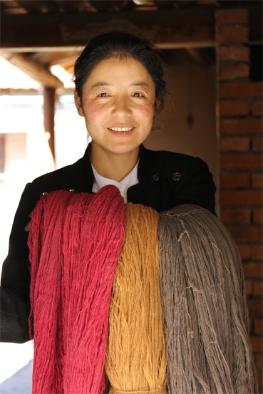 Woman with different colours of wool